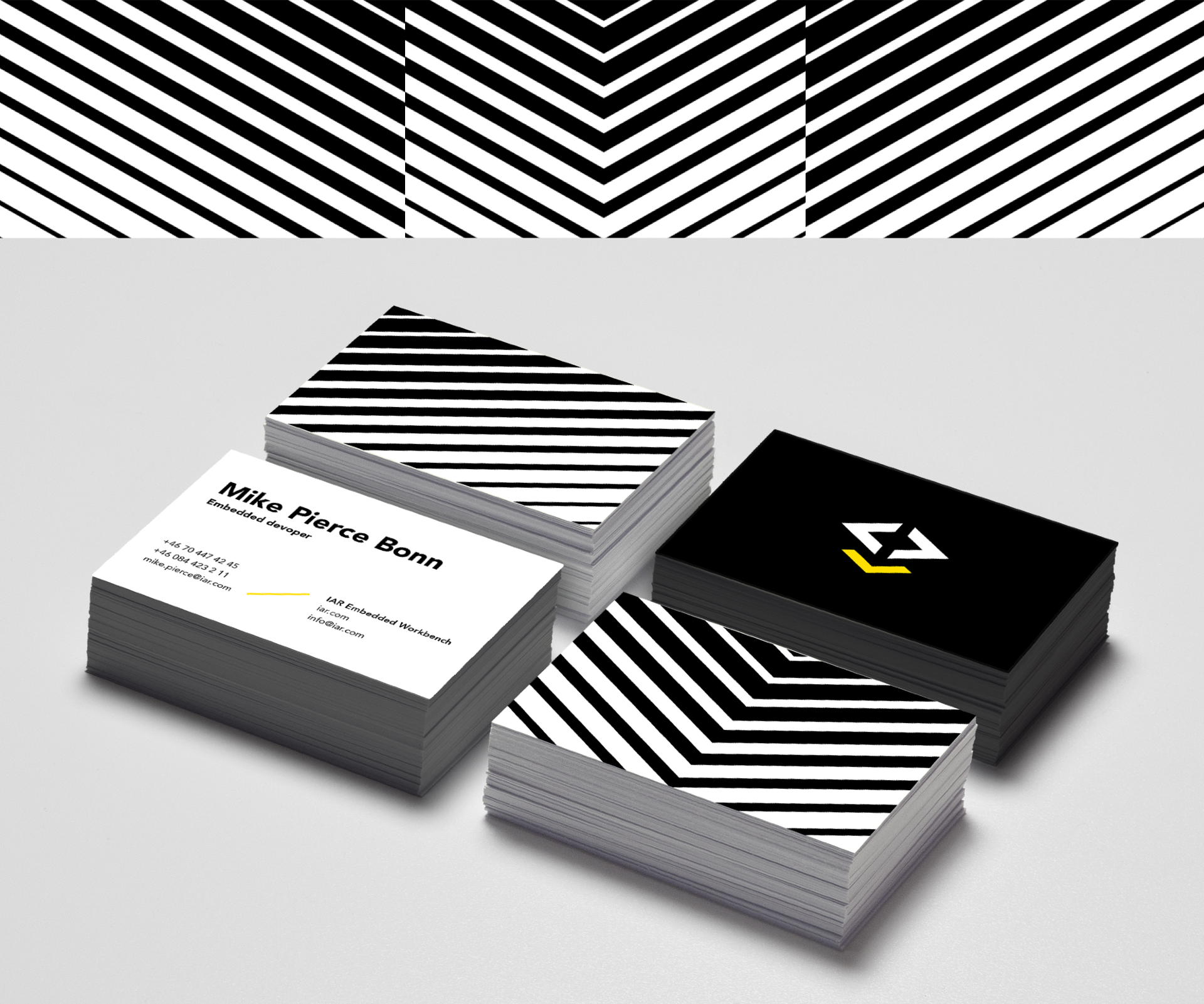 Brand design for IAR Embedded Workbench. Material from the process. Illustration showing the logotype in white and yellow on various Business cards.