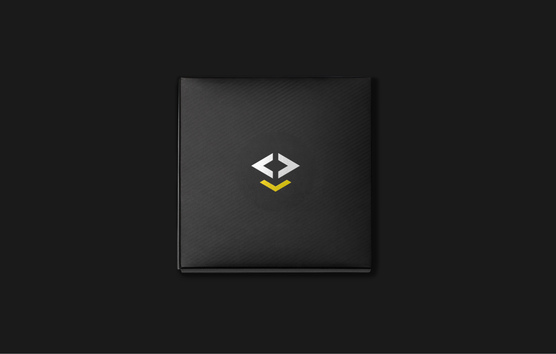 Brand design for IAR Embedded Workbench. Material from the process. Illustration showing the logotype in white and yellow on black packaging.